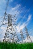 Electric high voltage power post. On blue sky Stock Photo