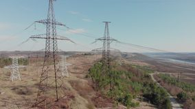 Electric high voltage pylon against sky. Aerial view from drone to power lines. Nature landscape, Sunny beautiful day.  stock video footage