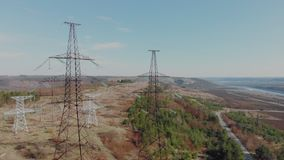 Electric high voltage pylon against sky. Aerial view from drone to power lines. Nature landscape, Sunny beautiful day.  stock footage