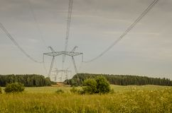 Electric high voltage tower/poles of power lines in the forest zone. Electric high voltage tower/ poles of power lines in the forest zone royalty free stock photography
