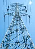Electric High Voltage Transmission Tower. With blue sky royalty free stock images