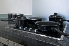 Electric hob. Four ring induction electric hob wit pan and pots Royalty Free Stock Images