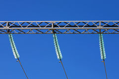 Electric insulators. Electric power transfer on wires Royalty Free Stock Photography