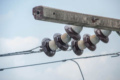 Electric insulators on pylon Royalty Free Stock Image