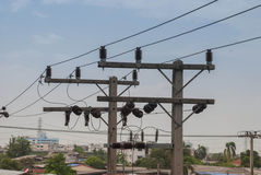 Electric insulators on pylon Stock Photo
