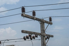 Electric insulators on pylon Stock Photography