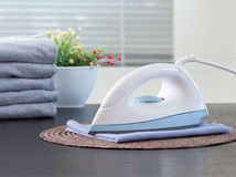 Electric iron in the laundry room  Royalty Free Stock Photos