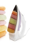 Electric iron. And stack towels Stock Images