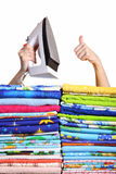 Electric iron. Household iron and greater pile of bed-clothes on a white background Stock Photo
