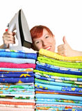 Electric iron. Household iron and greater pile of bed-clothes on a white background Royalty Free Stock Photography