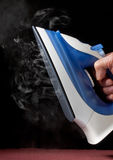 Electric iron on black background Stock Images