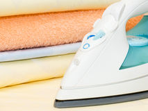 Electric iron and clothes Royalty Free Stock Image