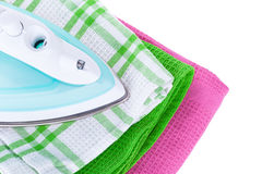 Electric iron and clothes Royalty Free Stock Photo