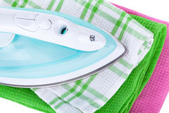 Electric iron and clothes Royalty Free Stock Photography