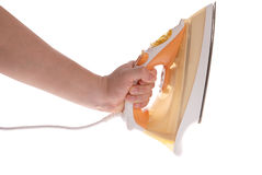 Electric iron in a hand Stock Photo