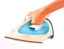 Electric iron in hand isolated Stock Photo