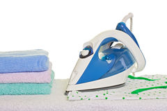 Electric iron and ironed clothes Royalty Free Stock Images