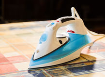 Electric iron for Ironing. Ironing room. Household items Stock Photos