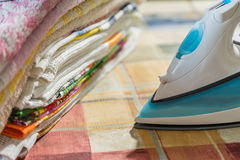 Electric iron for Ironing. Ironing room. Household items Royalty Free Stock Photography