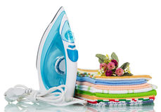 Electric iron and ironing things with a flower  on white Royalty Free Stock Photography