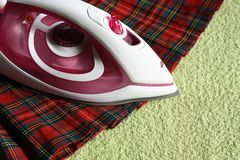 Electric iron and kilt Royalty Free Stock Images