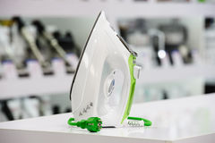 Electric iron in retail store Royalty Free Stock Photography