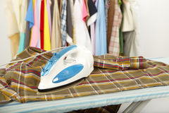 Electric iron and shirt Stock Photography