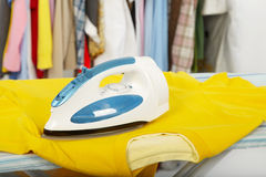 Electric iron and shirt Stock Images