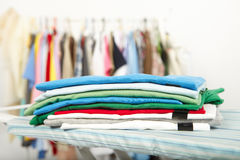 Electric iron and shirt Royalty Free Stock Photography