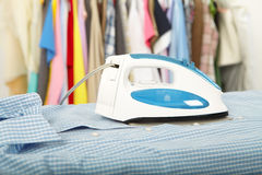 Electric iron and shirt Stock Image