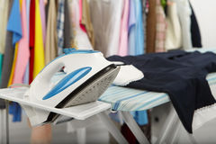 Electric iron and shirt Stock Photos
