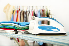 Electric iron and shirt Royalty Free Stock Images