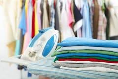 Electric iron and shirt Stock Photos