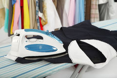 Electric iron and shirt Royalty Free Stock Photo