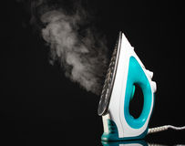Electric iron with steam Royalty Free Stock Photography