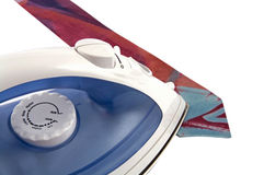 Electric iron and tie Royalty Free Stock Photo