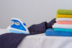 Electric iron and trousers Royalty Free Stock Images