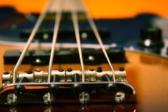Electric Jazz Bass Close-up. Close-up of a sunburst electric jazz bass guitar. Detail of bridge royalty free stock photography