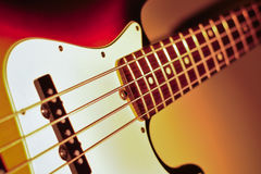 Electric jazz bass on a dramatic light Royalty Free Stock Images