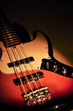 Electric jazz bass on a dramatic light Royalty Free Stock Photos