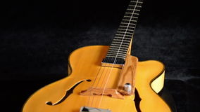 Electric Jazz Guitar Rotating, detail of pickup, strings, frets and efes. Classic Electric Guitar Jazz Rotating in Horizontal stock footage