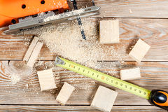 Electric jigsaw with many wooden bricks Royalty Free Stock Images