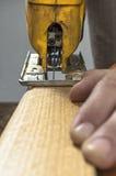 Electric jigsaw tool cutting wood Stock Image