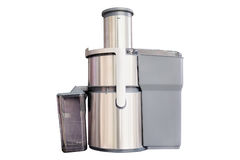Electric juice extractor with plastic container Royalty Free Stock Photography