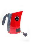 Electric kettle. Red electric kettle isolated on white royalty free stock photo