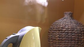 Electric kettle boils and switch off button. Close up. Whisker vase  background stock video footage