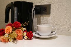 Electric kettle and coffee cup in the kitcjen stock images