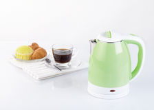 Electric kettle. With coffee cup and snack on white background Royalty Free Stock Images