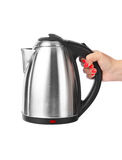 Electric kettle in hand Royalty Free Stock Images