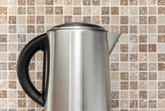 Electric kettle on kitchen tile background Royalty Free Stock Photography